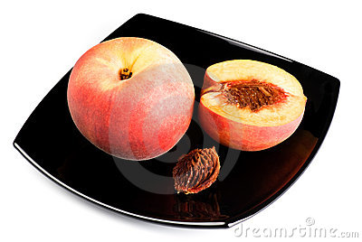 Red peaches with pip on black dish