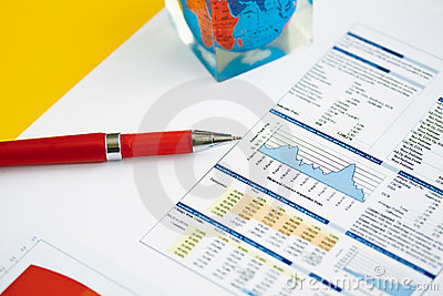 Red pen on a background of finance diagram.