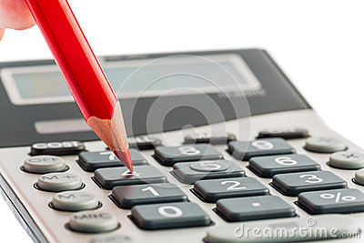 Red pencil and calculator