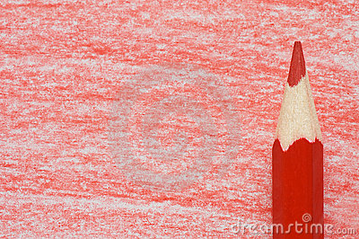 Red pencil with coloring on a  paper