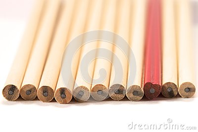 Red pencil among wooden