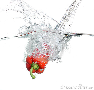 Free Red Pepper Falling Into Water Over White Stock Photo - 25177990