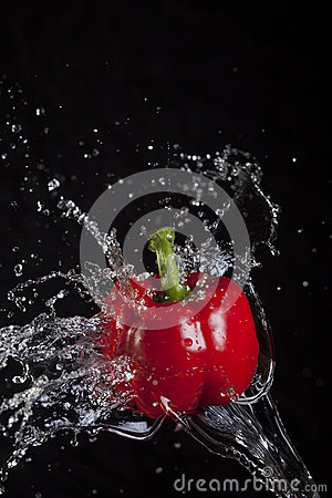 Red pepper splashed by water.