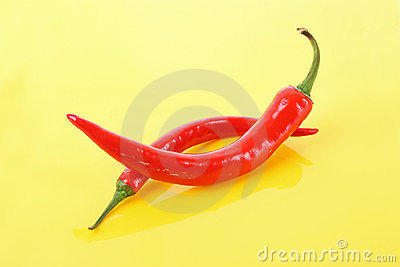 Red peppers on a yellow