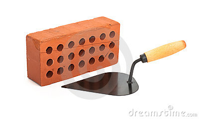 Red perforated ceramic brick and trowel isolated