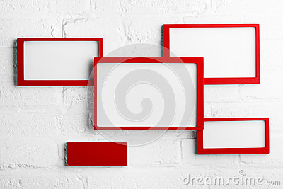Red picture frame on white wall