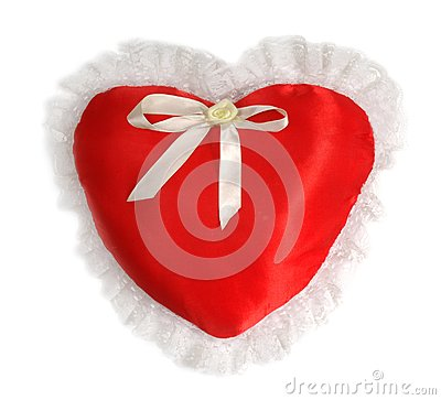 Red pillow as a heart on the day of sainted Valentine on a white