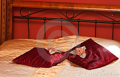 Red pillows on bed