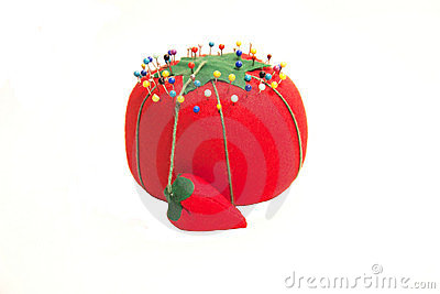 Red pin cushion with pins