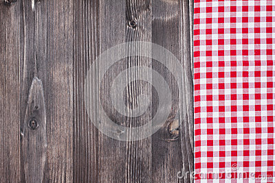 Red plaid cloth on dark wood