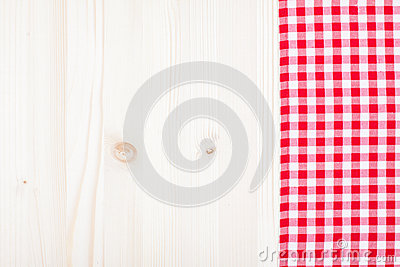 Red plaid cloth on white wood
