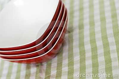 Red plastic bowls green cloth