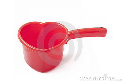 Red plastic ladle similar to a heart