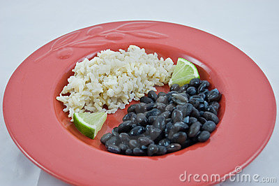 Red Plate of Brown Rice and Black Beans with Lime