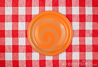 Red plate on checked tablecloth