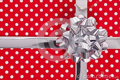 Red polka dot gift with silver bow and ribbon