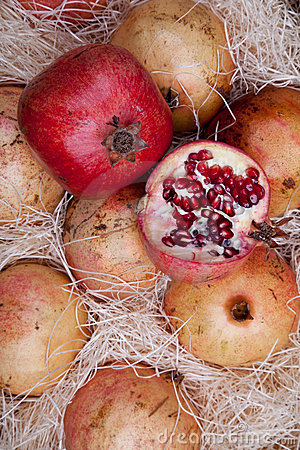 Red pomegranates in a box