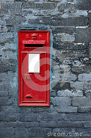 Red post box set in wall