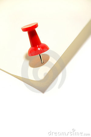 Red pushpin and note paper