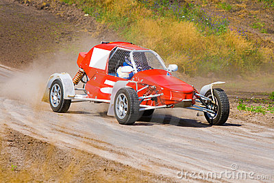 Red racing buggy on track