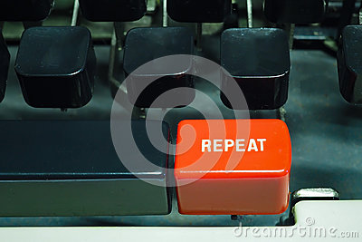 Red repeat button on typewriter. Do something again Stock Photo