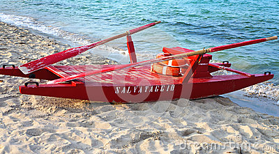 Red rescue boat on an italian beach
