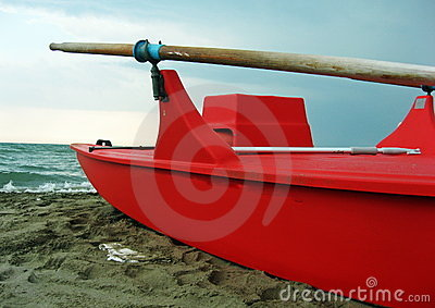 Red rescue boat with wooden oars