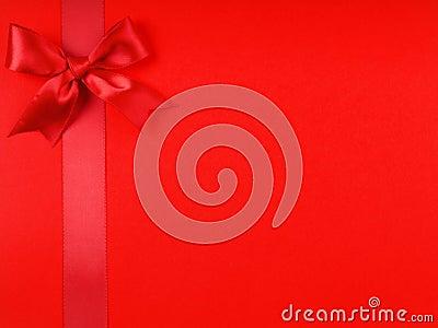 A red ribbon bows