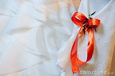 Red ribbon on white fabric