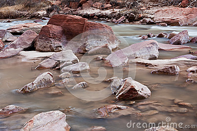 Red rocks on a river bed