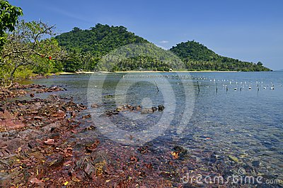 Red rocks and translucid sea at Cambodian island