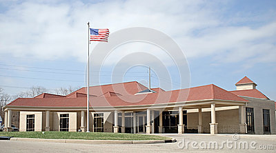 Red Roof Building with Flag