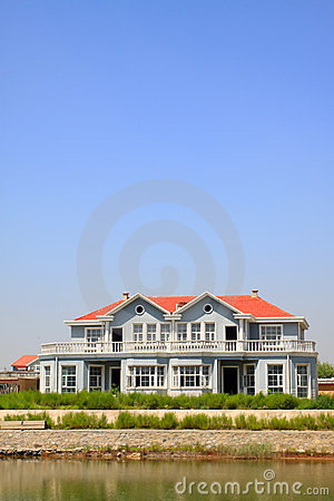 Red roof building at water s edge