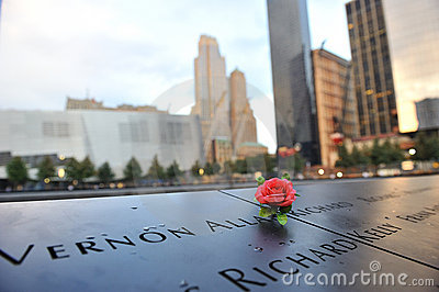 Red rose on 911 memorial Editorial Stock Photo