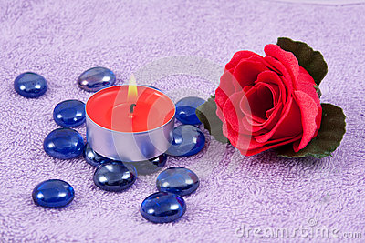 Red  rose and aroma candle on the towel