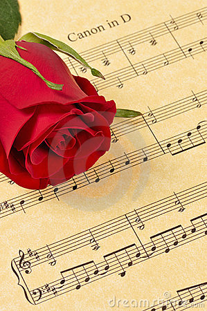 Red Rose Bud on Sheet Music