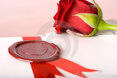 Red rose and love-letter with seal