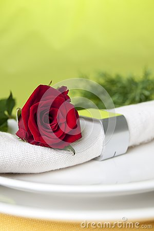 Red rose and napkin