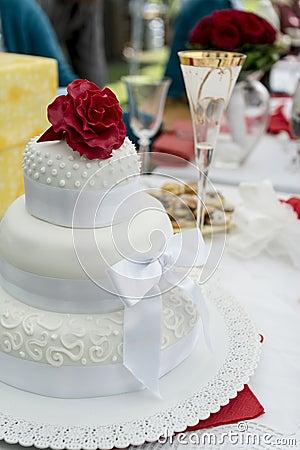 Red rose on a wedding cake
