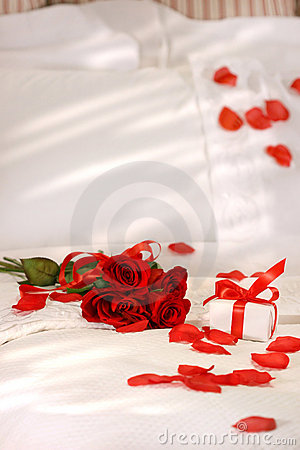 Red roses on a bed