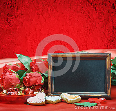 Red roses and blackboard with space for text