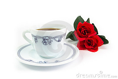Red roses with cup of coffee