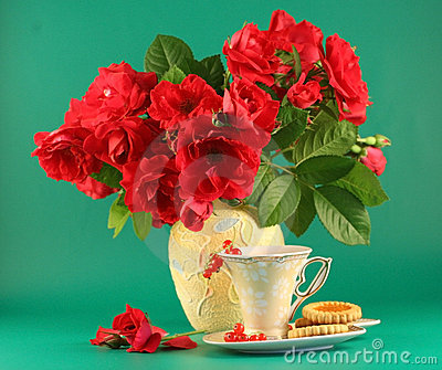 Red roses and a cup of tea
