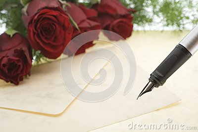 Red roses with envelope and pen