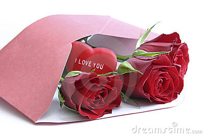 Red roses in envelope on white