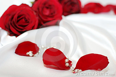 Red roses petals and pearles
