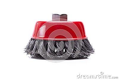 Red rotating metal brush or grinding disk
