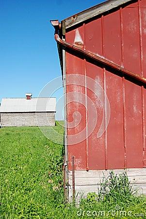A red rural barn on farmland