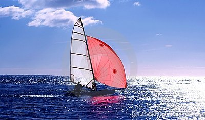 Red Sail, dinghy sailing into the sun on a blue sea : Dreamstime