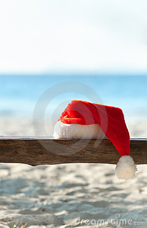 Free Red Santa S Hat On Wooden Bench On The Beach Royalty Free Stock Photography - 16411537